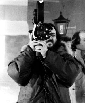 THE SHINING, Director Stanley Kubrick checks a camera set-upm 1980