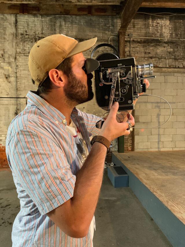 Derick Crucius holding his Bolex H16 capturing a scene