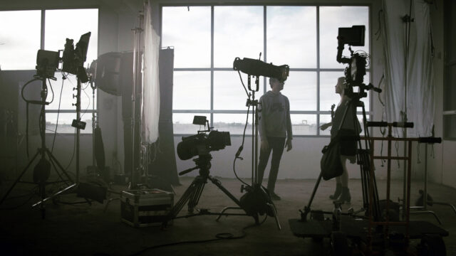 On set for the Frames - Hell music video, lighting and camera equipment set up