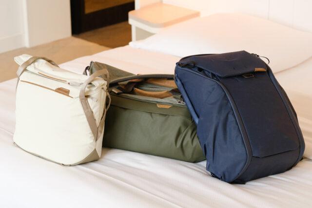 Peak Design Everyday bags on freshly made hotel bed