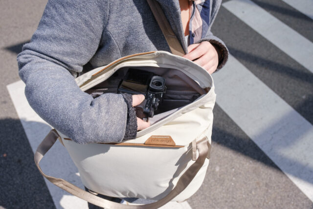 A female photographer takes a FUJIFILM X-T3 out of a Peak Design Everyday Tote bag
