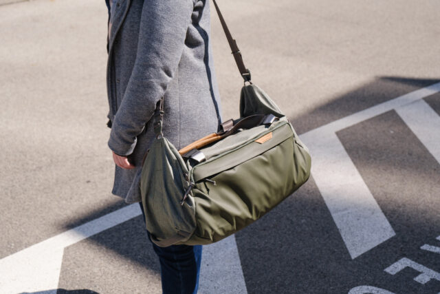 Peak Design Travel Duffel bag 35L worn around a woman's shoulder