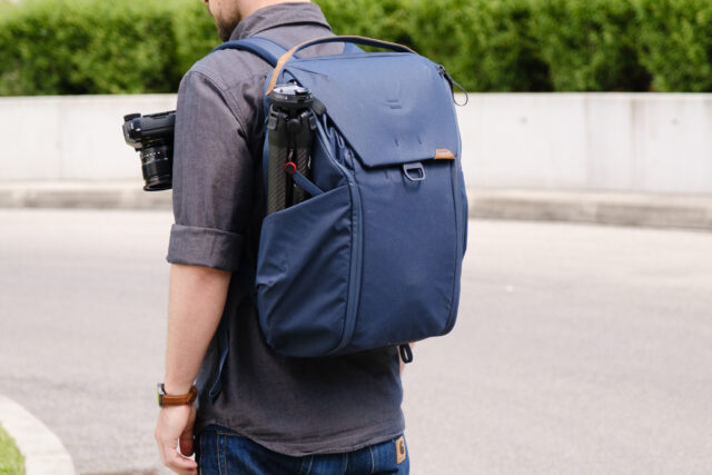 The Peak Design Everyday Backpack with a Travel Tripod and Capture Clip attached